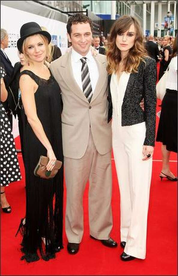 Actors (L-R) Sienna Miller, Matthew Rhys and Keira Knightley arrive at the world premiere of 'The Edge Of Love', on the opening night of the 62nd Edinburgh International Film Festival, at Cineworld, Fountain Park on Wednesday in Edinburgh, Scotland. Photo: Getty Images
