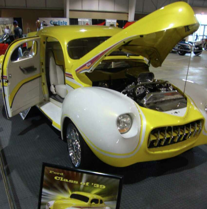 The yellow-and-white paint job on this 1939 Ford Coupe wasn't available from the factory back then, but it looks great anyway. Most of the car is customized, so not much is original anyway.