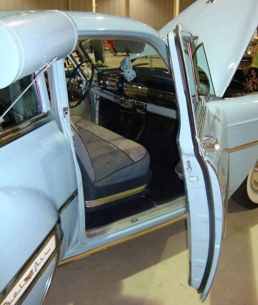 This 1953 Chevrolet Bel Air four-door sedan, completed with window-mounted air cooler, is all original except for the paint. It has only 76,390 miles on it, said the owners, Chandra and Jason Fryer of San Antonio.