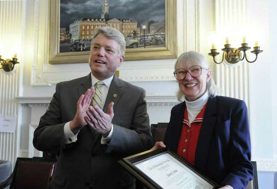 Schenectady Mayor Brian U. Stratton presents  Sharon A. Jordan, his Chief of Staff, with the Schenectady Patroon award  during his going away pizza party at City Hall in Schenectady Thursday March 24,2011. Stratton will be leaving his office to take a job as director of the New York State Canal Corp. ( Michael P. Farrell / Times Union ) Photo: Michael P. Farrell