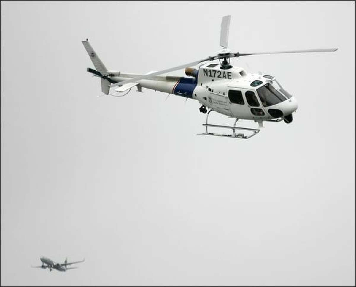 A U.S. Customs and Border Protection helicopter flies in to the American Heroes Air Show, Saturday, June 14, 2008. This is the fourth year the show has been in Seattle, with about 15 aircraft on display to the public.