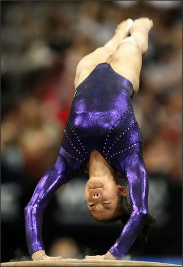 Ivana Hong warms up on the vault. Photo: Getty Images