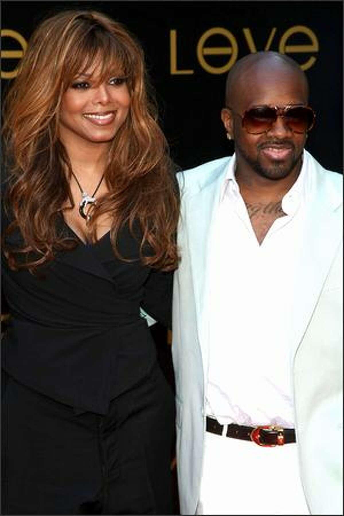 Singer Janet Jackson (left) and producer Jermaine Dupri arrive.