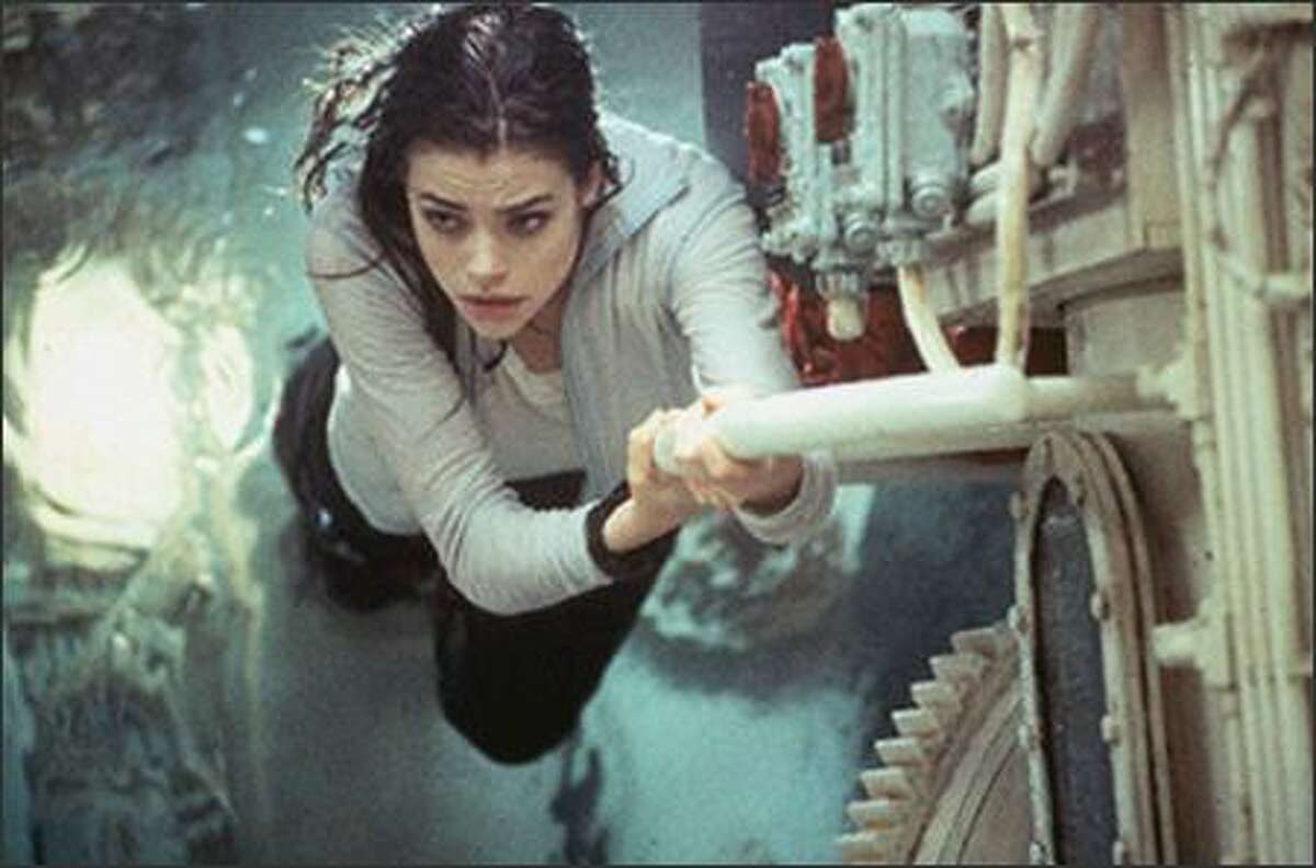 """Worst Bond girl: Denise Richards as nuclear scientist Christmas Jones in """"The World is Not Enough"""" from 1999."""