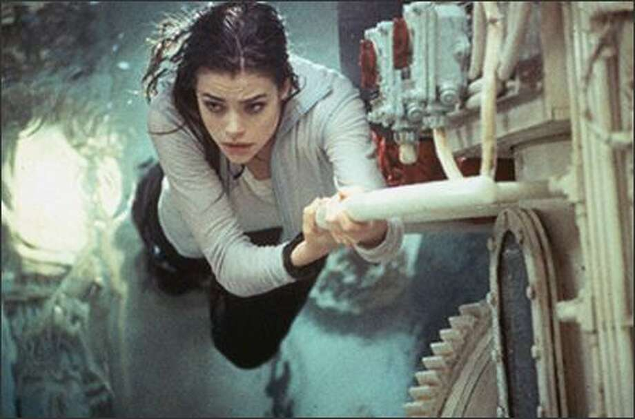 """Worst Bond girl: Denise Richards as nuclear scientist Christmas Jones in """"The World is Not Enough"""" from 1999. Photo: /"""