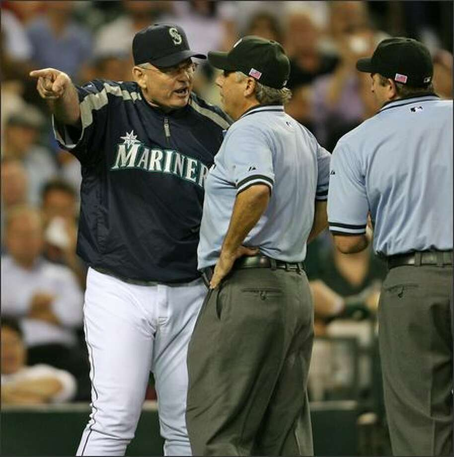 Seattle Mariners manager John McLaren argures with second base umpire and crew chief Tom Hallion after being ejected by plate umpire Chris Guccione as the M's play the Oakland Athletics during fourth inning action at Safeco Field in Seattle, Wash., Tuesday Sept. 11, 2007. Photo: Mike Urban, Seattle Post-Intelligencer