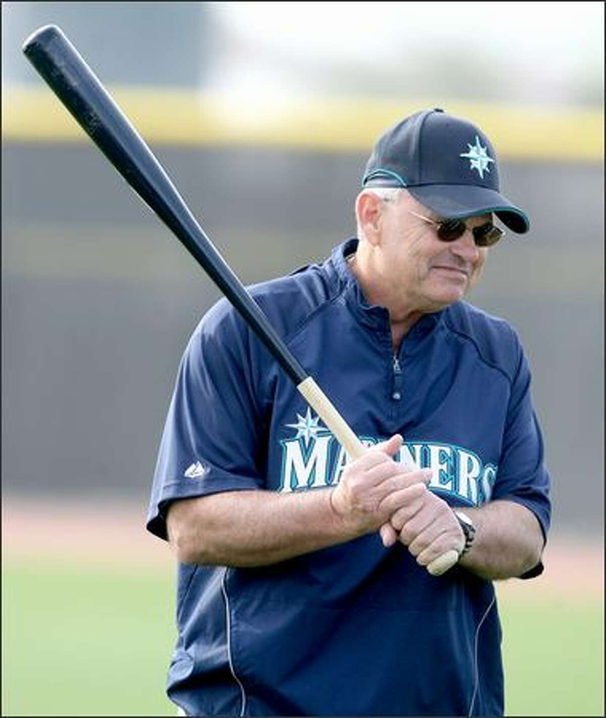 Mariners' manager John McLaren carries around a big stick at the first full squad workout of the Seattle Mariners at the Mariners training facility in Peoria, Ariz. on Wedday February 20, 2008.