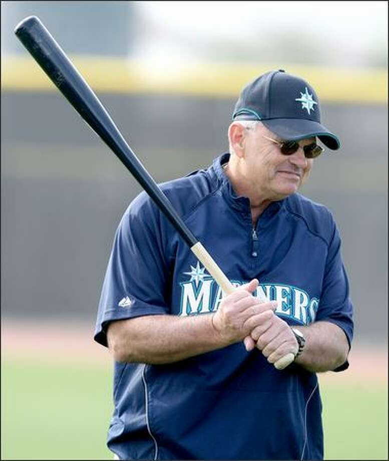 Mariners' manager John McLaren carries around a big stick at the first full squad workout of the Seattle Mariners at the Mariners training facility in Peoria, Ariz. on Wedday February 20, 2008. Photo: Seattle Post-Intelligencer