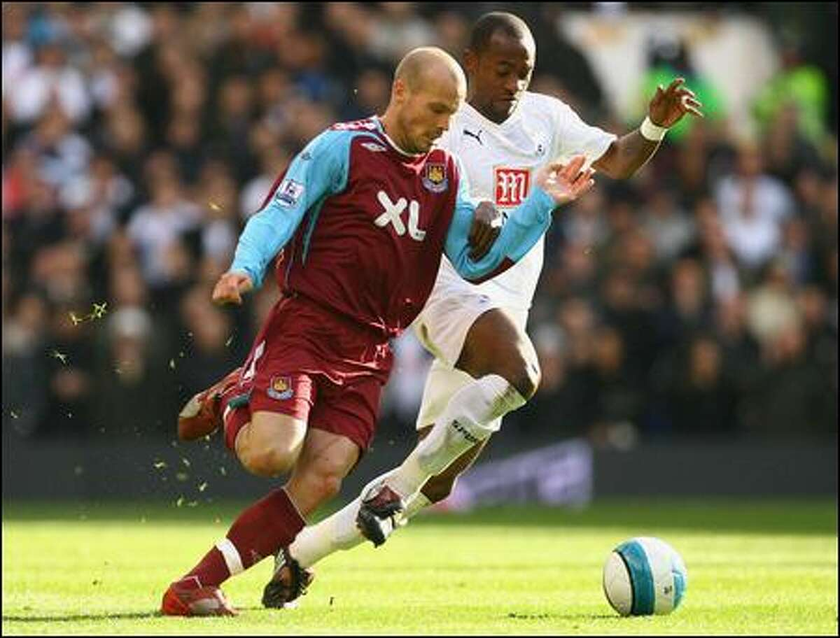 Swedish star Fredrik Ljungberg, left, appears fully recovered from injuries that limited him to just 22 starts in 38 league matches for West Ham last season