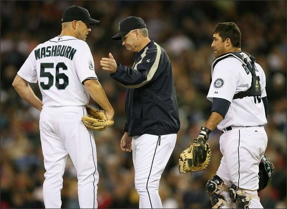 Starting pitcher Jarrod Washburn #56 of the Seattle Mariners is removed from the game in the fifth inning by manager John McLaren #8 against the Tampa Bay Devil Rays on September 16, 2007 at Safeco Field in Seattle, Washington. Catcher Jamie Burke #15 is at right. Photo: Getty Images