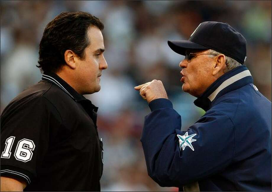 Manager John McLaren of the Seattle Mariners argues with home plate umpire Mike DiMuro #16 after being ejected after arguing a strike out call against the New York Yankees at Yankee Stadium May 23, 2008 in the Bronx borough of New York City. Photo: Getty Images