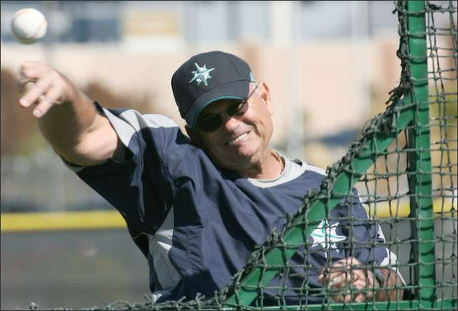 Bench coach John McLaren throws batting practice on Monday. Day 12 of Seattle mariners spring Training in Peoria, AZ, Monday, February 26, 2007. Photo: Grant M. Haller, Seattle Post-Intelligencer