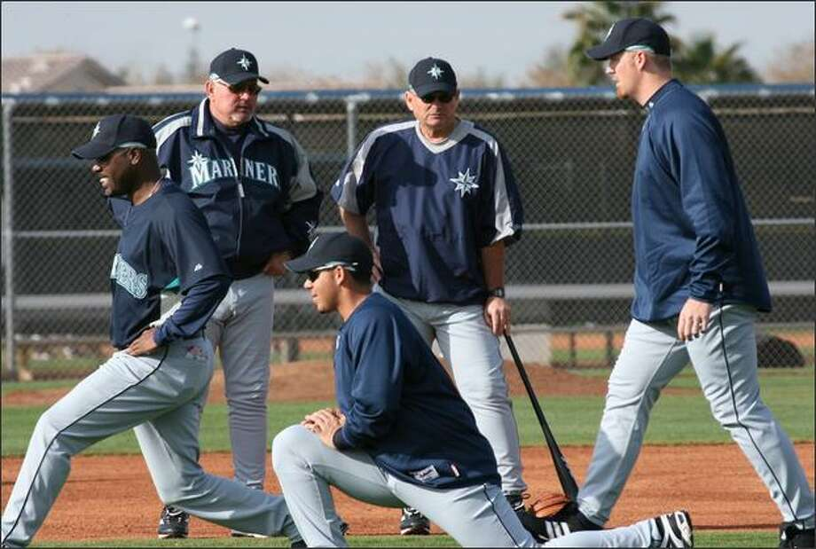 "Mariners manager Mike Hargrove, left, and John McLaren, Bench coach, watch the team go through their ""Team Stretch"". The 2007 Seattle Mariners took to the ball fields in Peoria for the first full squad workout of the Spring Training season. More than 60 players took to the fields looking for work this Spring, Summer and Fall. Tuesday, February 20, 2007 Peoria, AZ. Photo: Grant M. Haller, Seattle Post-Intelligencer"
