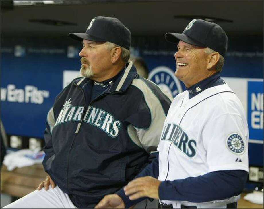 Mariners manager Mike Hargrove, left, looks out of the dugout with bench coach John McLaren before opening day at Safeco Field on Monday, April 2, 2007. Photo: Dan DeLong, Seattle Post-Intelligencer