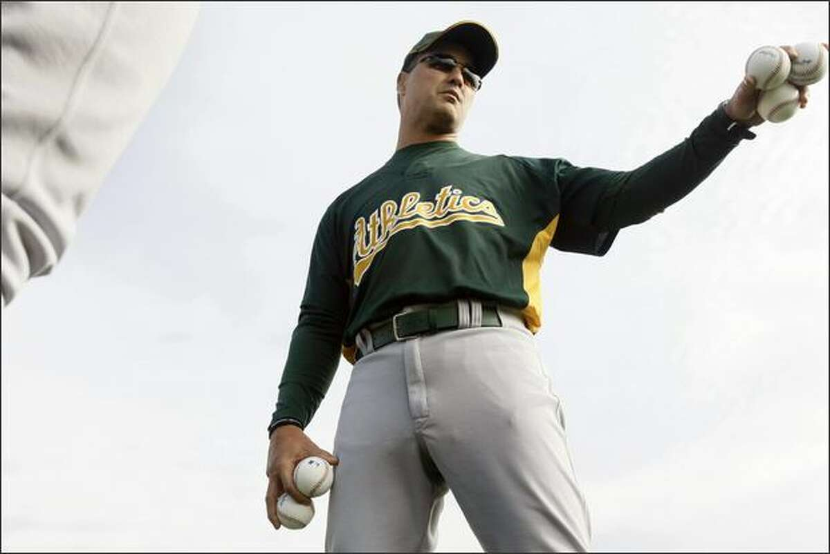 Oakland Athletics new bench coach Don Wakamatsu talks with his players during the first day of spring training at Papago Park in Phoenix on Feb. 17, 2008. (Lance Iversen/The San Francisco Chronicle)