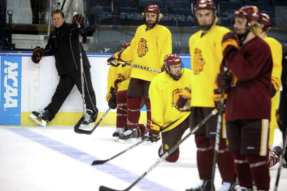 Head coach Scott Sandelin and the University of Minnnesota Duluth men's hockey team practice at the Webster Bank Arena in Bridgeport, Conn. Thursday, March 24th, 2011. UMD will play of Union College Friday in the NCAA East Regional Semifinal. Photo: Ned Gerard / Connecticut Post