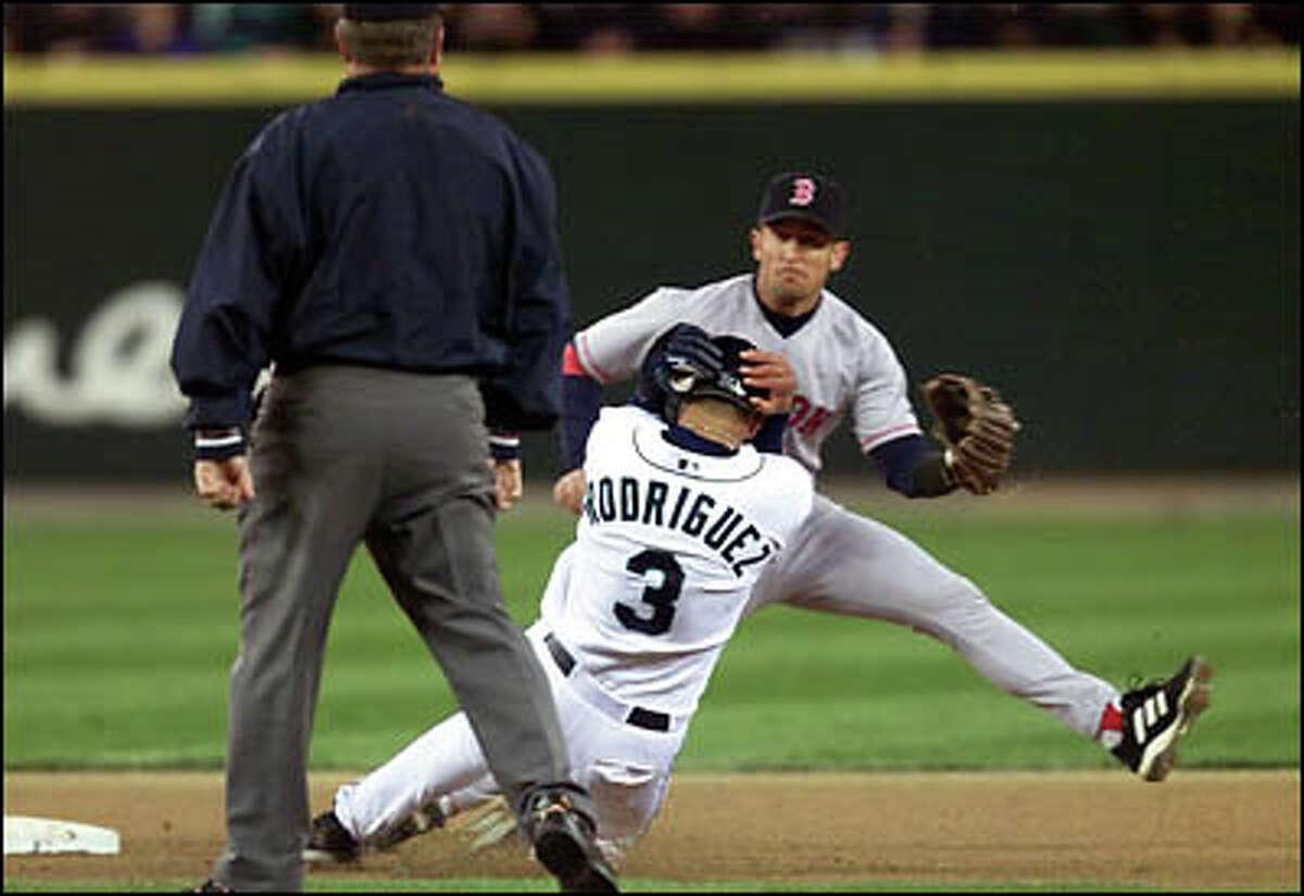 Alex Rodriguez slides into second base after a passed ball on Red Sox catcher Jason Varitek.