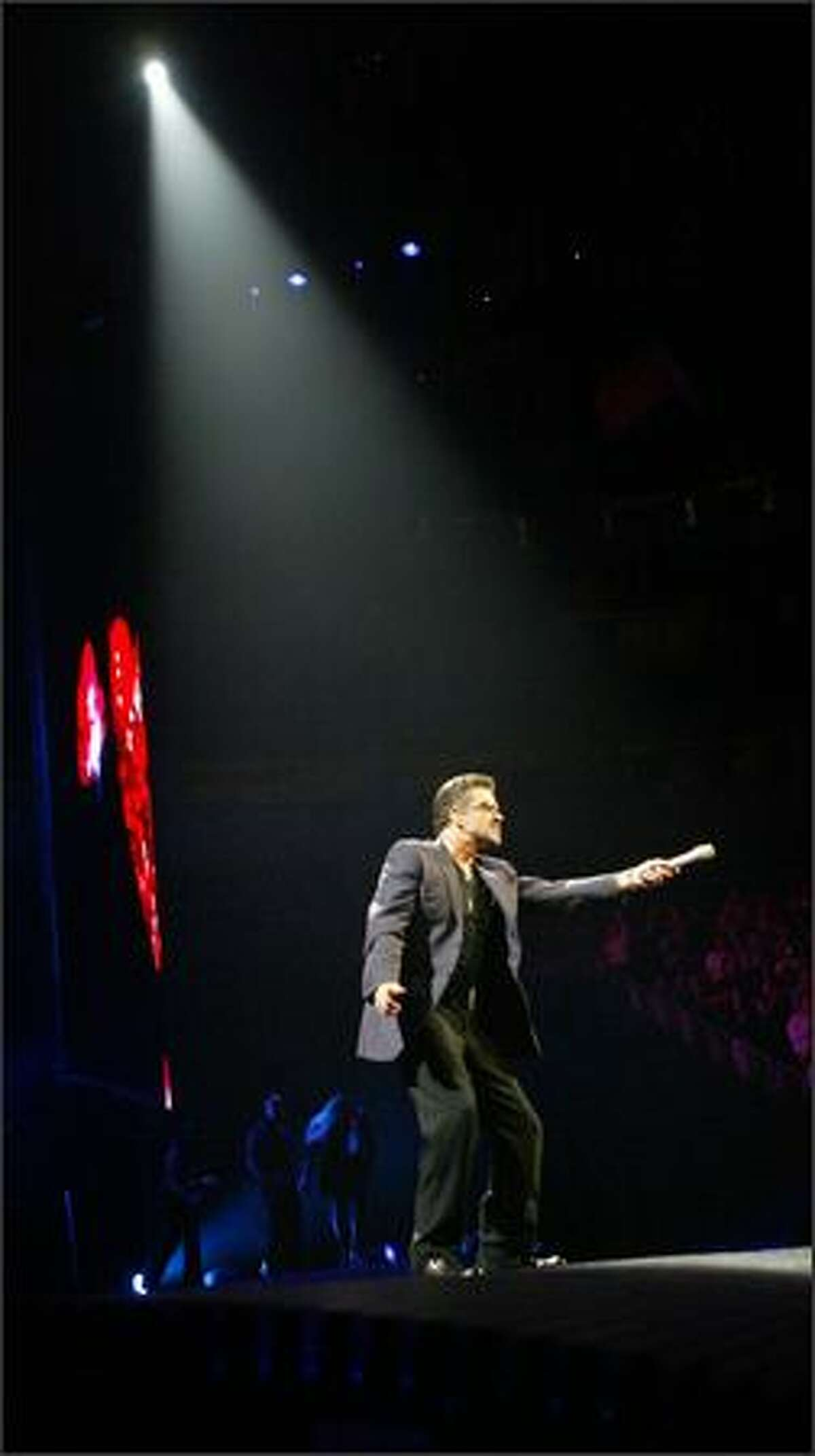 George Michael sings Fast Love in concert at Seattle's Key Arena.