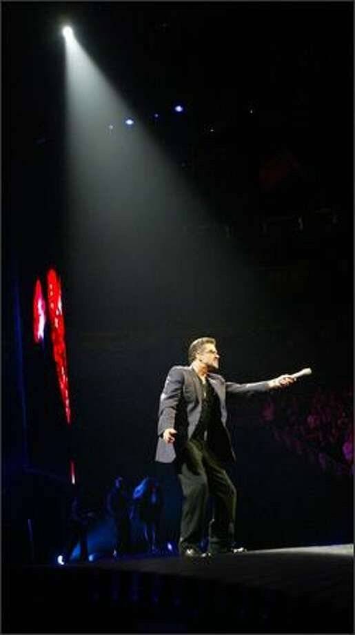 George Michael sings Fast Love in concert at Seattle's Key Arena. Photo: Grant M. Haller, Seattle Post-Intelligencer