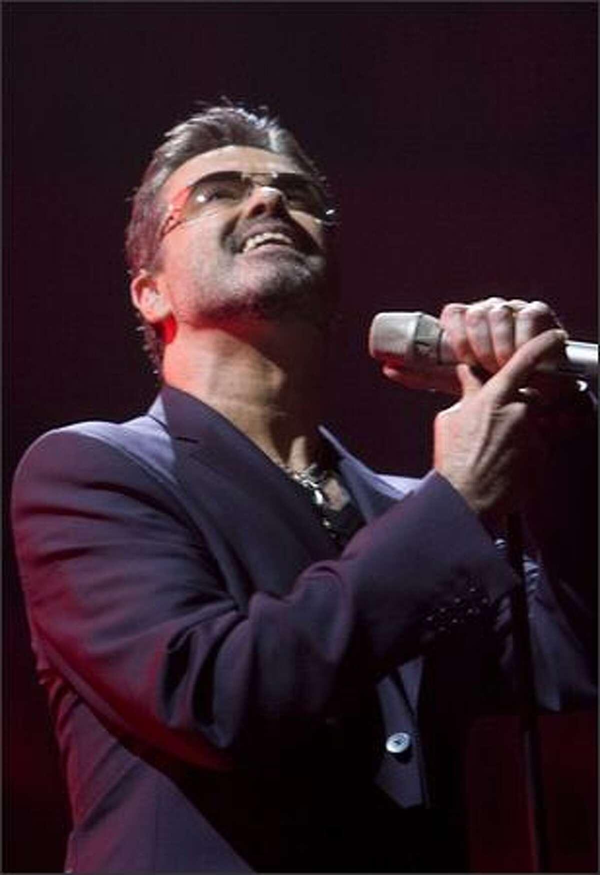 George Michael sings Fast Love.