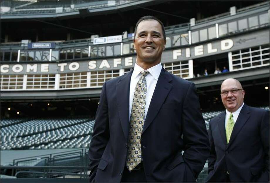 New Mariners manager Don Wakamatsu, joined by general manager Jack Zduriencik, right, met with the media at Safeco Field as the majors' first Asian-American manager. Photo: Brad Vest/Seattle Post-Intelligencer