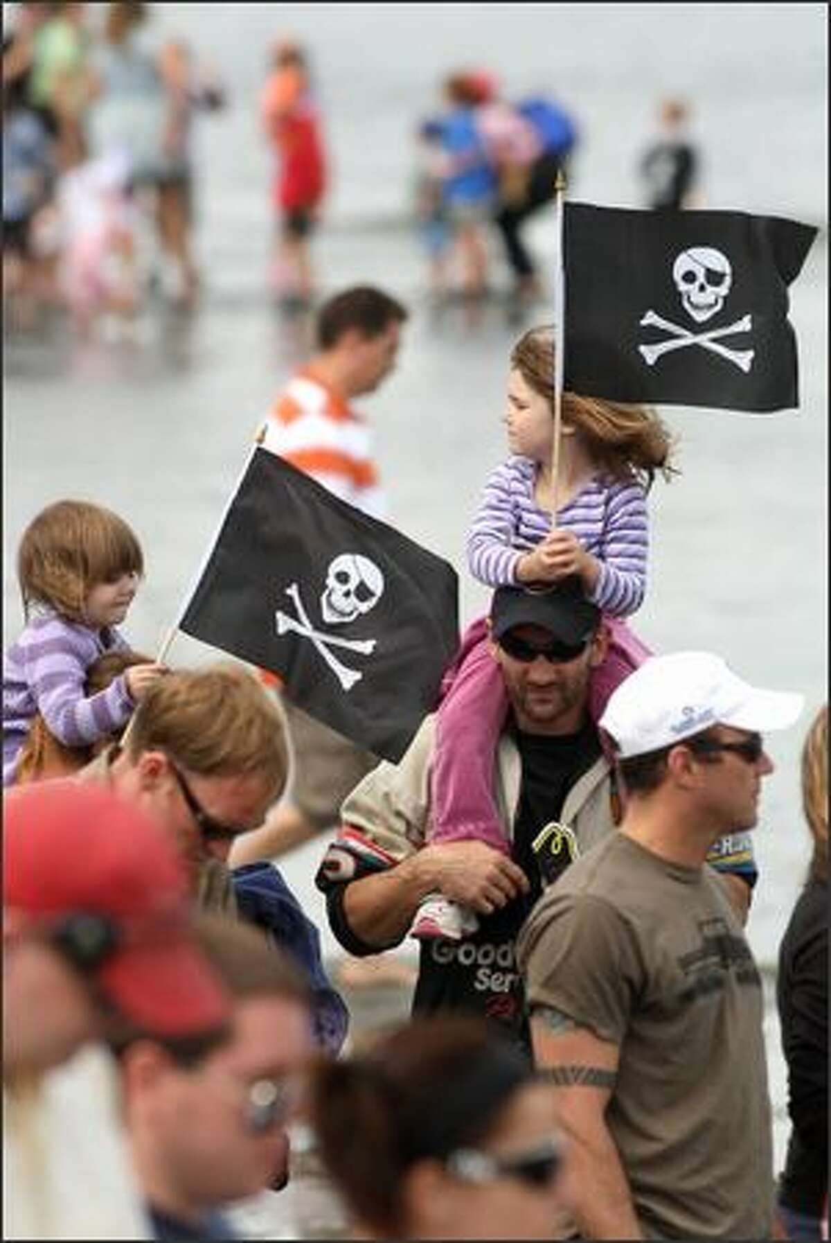 Spectators await the arrival of the Seafair Pirates.