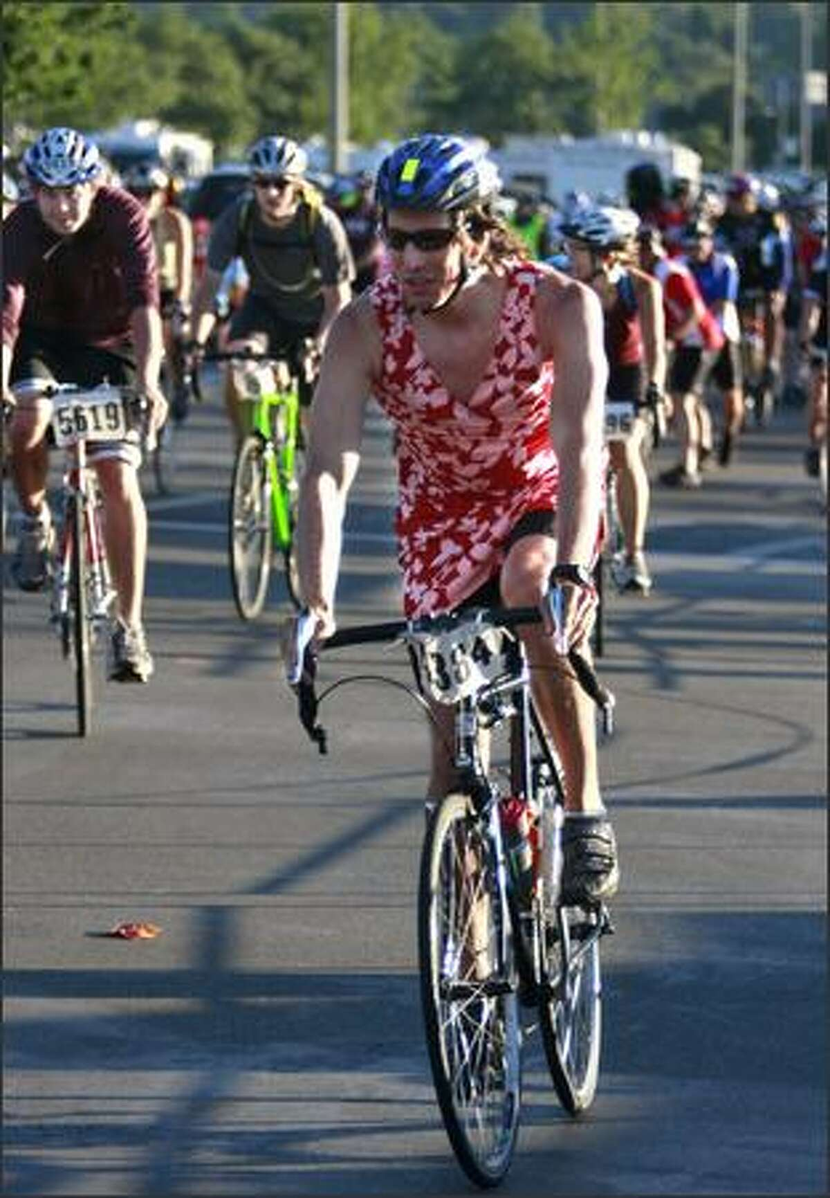 Bicyclists begin the ride.