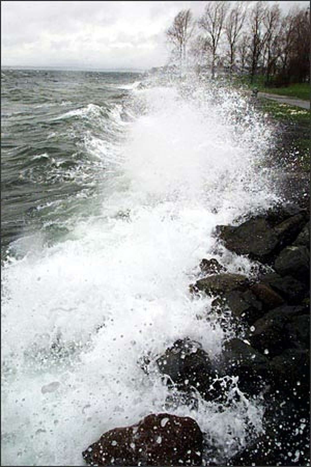 Strong winds and a high tide made for big waves that crashed into the shoreline of Myrtle Edwards Park in Seattle Friday.