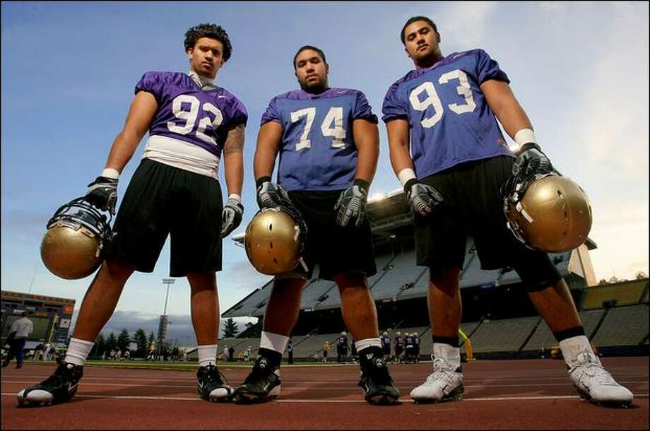 Freshmen Everrette Thompson, left, Alameda Ta'amu and Senio Kelemete have risen to the challenge of playing on the defensive line as the season has wound down. Photo: Scott Eklund/Seattle Post-Intelligencer