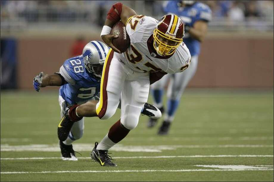 Shaun Alexander rushes against the Detroit Lions in the second quarter of  a game in Detroit last month. Alexander has gotten just 11 carries and gained 24 yards in four games since signing with the Redskins on Oct. 14. Photo: / Associated Press