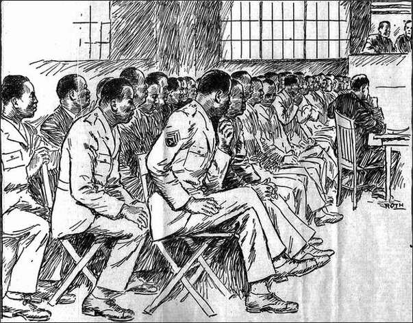 Published Nov. 22, 1944: Here are the 42 Negro soldiers on trial by court martial at Fort Lawton, charged with participating in a riot in which a former Italian prisoner of war was murdered and several others seriously injured. Note the rigid bodies and tense facial expressions of the defendants seated in the courtroom. They were sketched by Henry Roth, Post-Intelligencer staff artist. Photo: Seattle Post-Intelligencer
