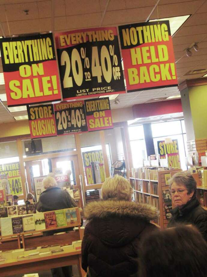 Customers of Borders bookstore in Fairfield took advantage of sales Thursday, the first day of the downtown hub's liquidation sale. Photo: Kirk Lang / Fairfield Citizen