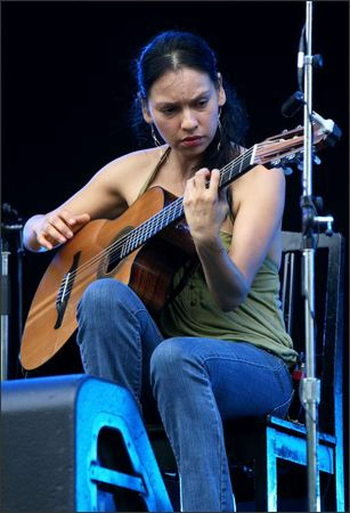Gabriela Quintero of Mexican guitar duo Rodrigo y Gabriela performs the opening act of the Fuji Rock Festival at Naeba Ski Resort in Yuzawa, Niigata, Japan.
