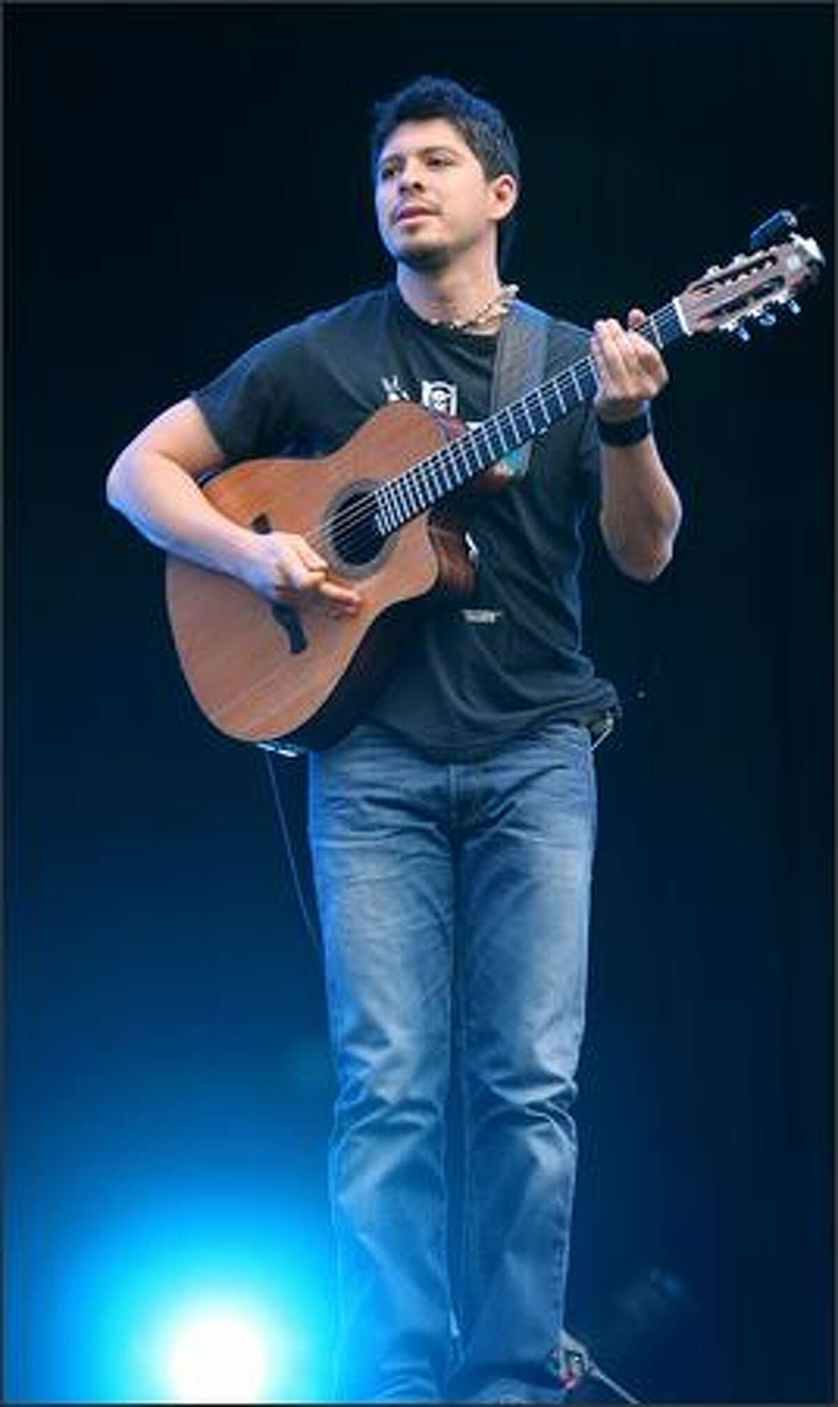 Rodrigo Sanchez of Mexican guitar duo Rodrigo y Gabriela performs the opening act of the Fuji Rock Festival at Naba Ski Resort in Yuzawa, Niigata, Japan.
