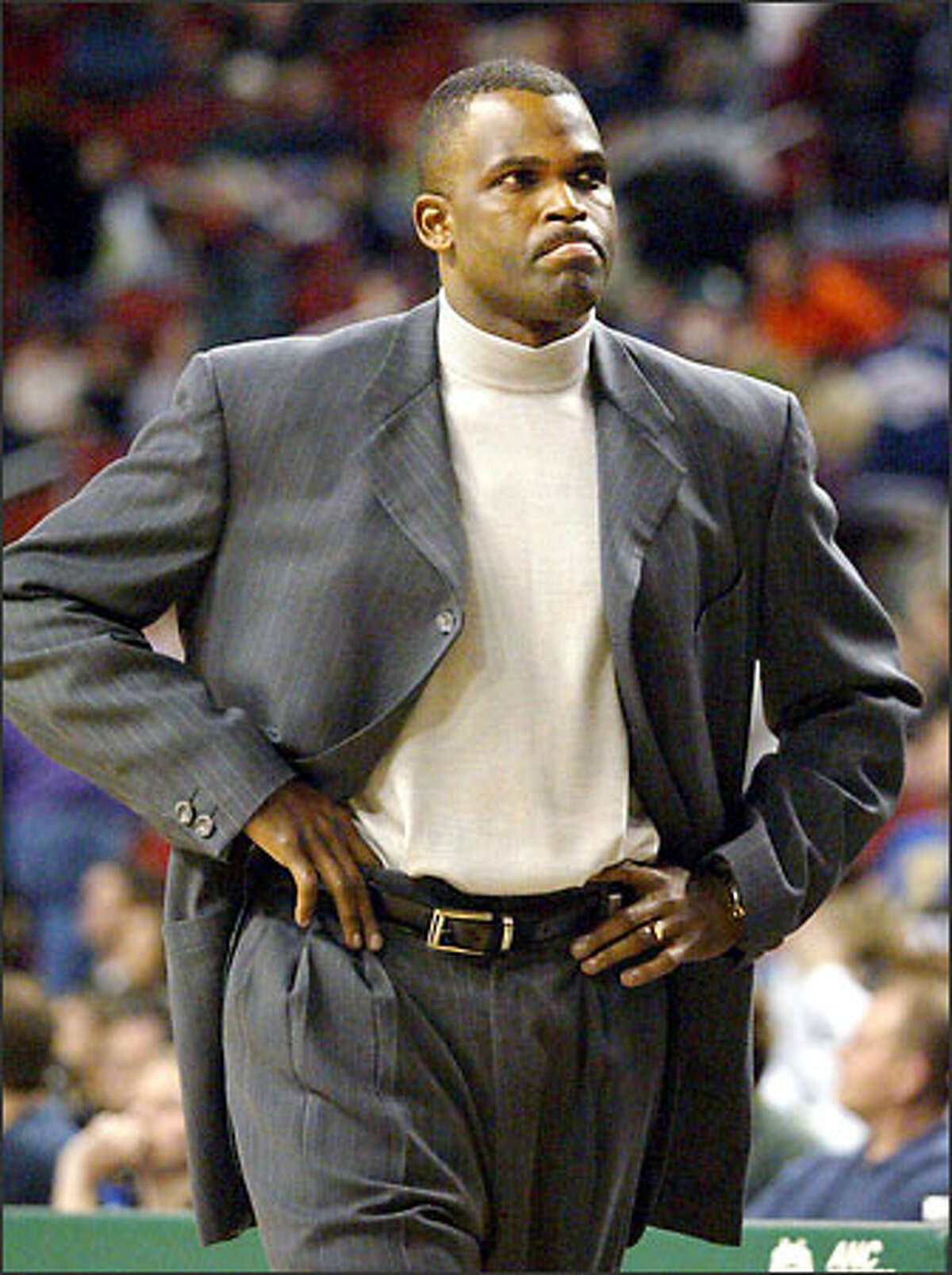 Sonics coach Nate McMillan walks off the court at the end of the game against the Cleveland Cavaliers. Cleveland won 87-79, handing the Sonics their fifth consecutive loss.