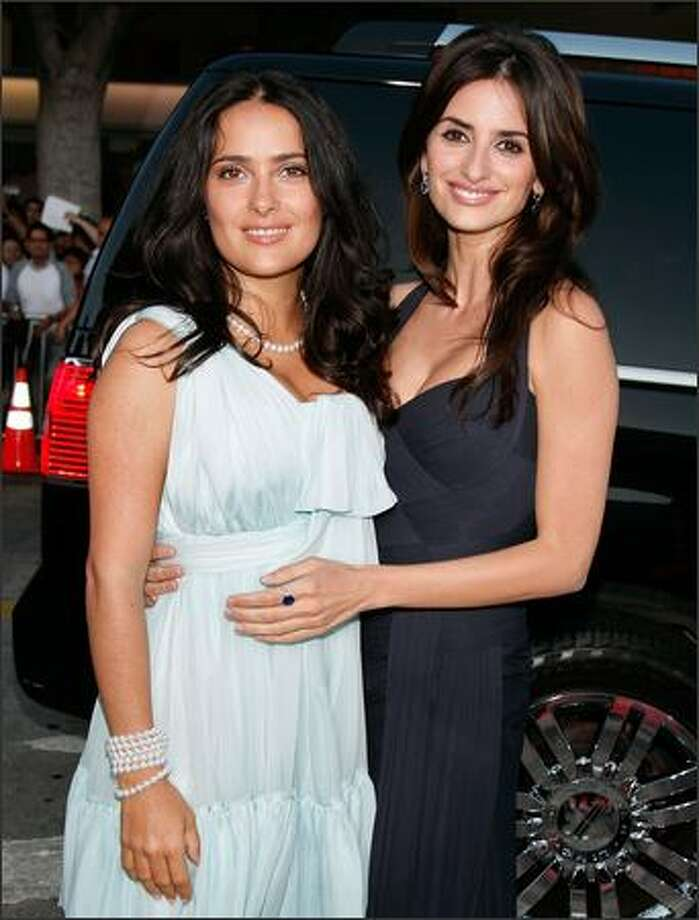 "Actresses Salma Hayek (L) and Penelope Cruz arrive on the red carpet at the Los Angeles Premiere of ""Vicky Cristina Barcelona"" at the Mann Village Theatre. Photo: Getty Images"