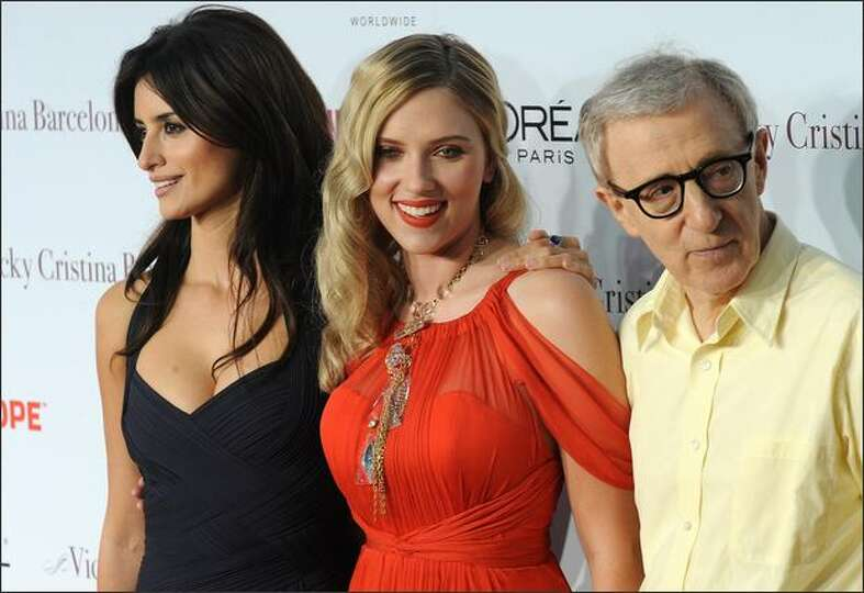 Cast members Penelope Cruz (L) and Scarlett Johansson pose with director Woody Allen (R) as they arr