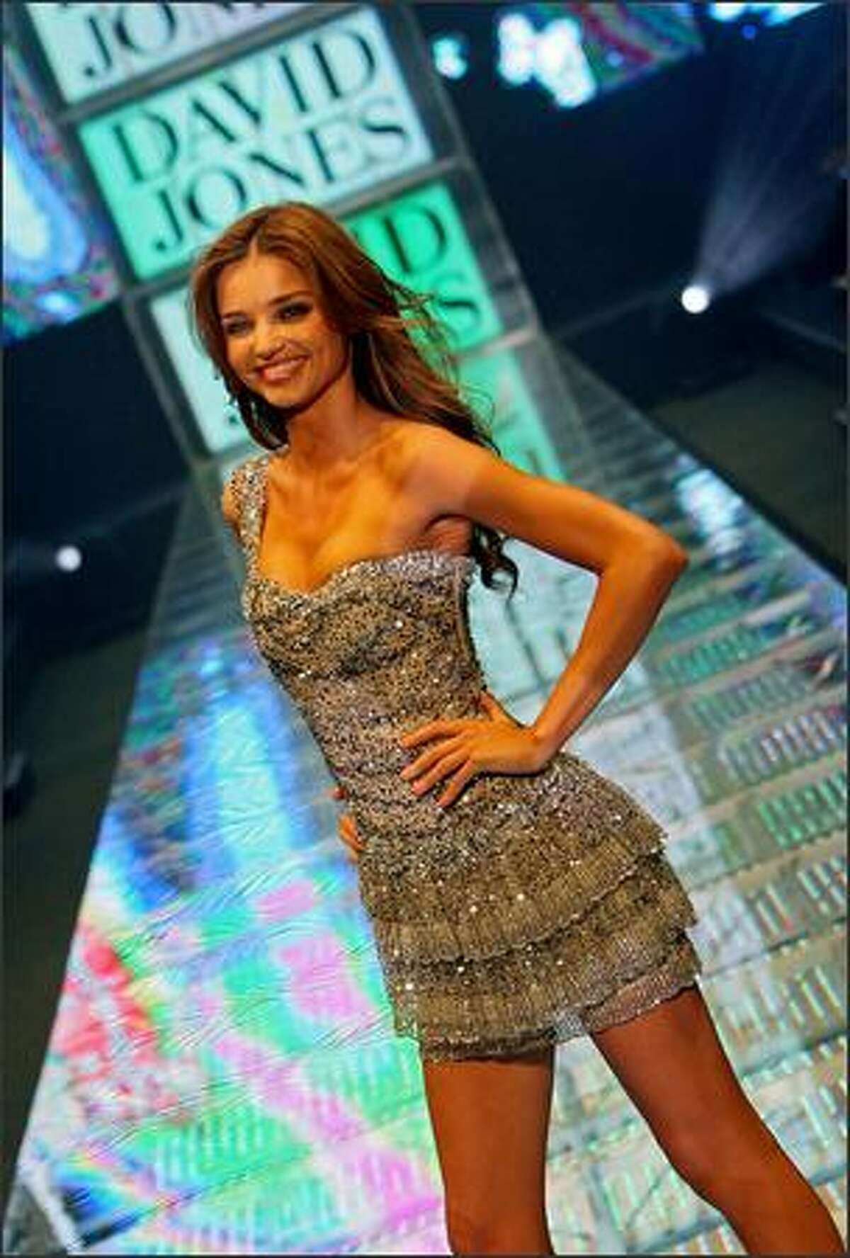 Australian supermodel Miranda Kerr parades a dress by Paris-based Australian designer Collette Dinnigan during the David Jones Summer Fashion Show in Sydney on August 5, 2008. The event was Miranda Kerr's debut appearance on the runway for retailer David Jones as the successor to former supermodel Megan Gale. AFP PHOTO/Torsten BLACKWOOD