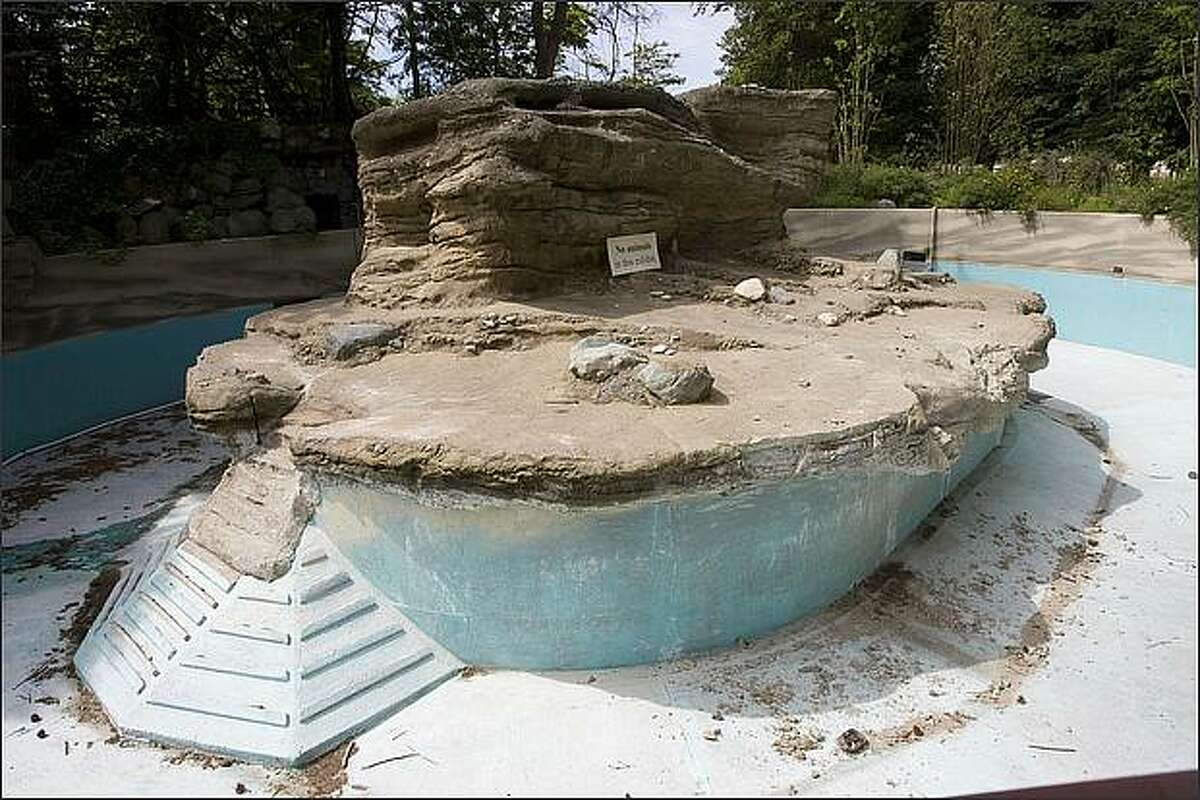 The empty penguin pool at Woodland Park Zoo. A new penguin exhibit opens in summer 2009, with plans for a larger colony of up to 20 breeding pairs. The current structure was built in 1947 for seals and sea lions. June 23, 2008.