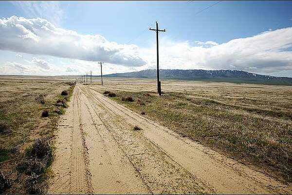 """A dirt road leads toward the Rattlesnake Hills in Benton County, Wash. """"I love the open, 360-degree horizons of Eastern Washington,"""" says the photographer. July 19, 2008"""