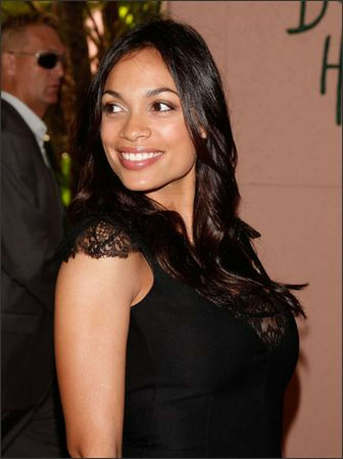 Actress Rosario Dawson arrives at the Hollywood Foreign Press Association's annual summer luncheon held at the Beverly Hills Hotel on Wednesday in Beverly Hills, Calif.