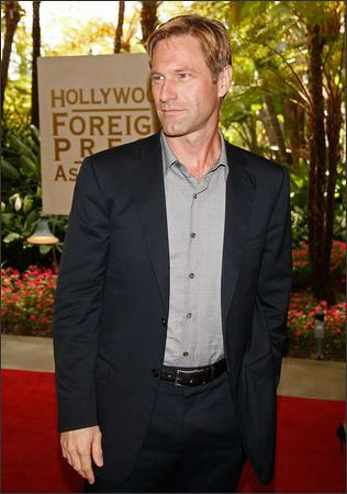 Actor Aaron Eckhart arrives at the Hollywood Foreign Press Association's annual summer luncheon held at the Beverly Hills Hotel on Wednesday in Beverly Hills, Calif.