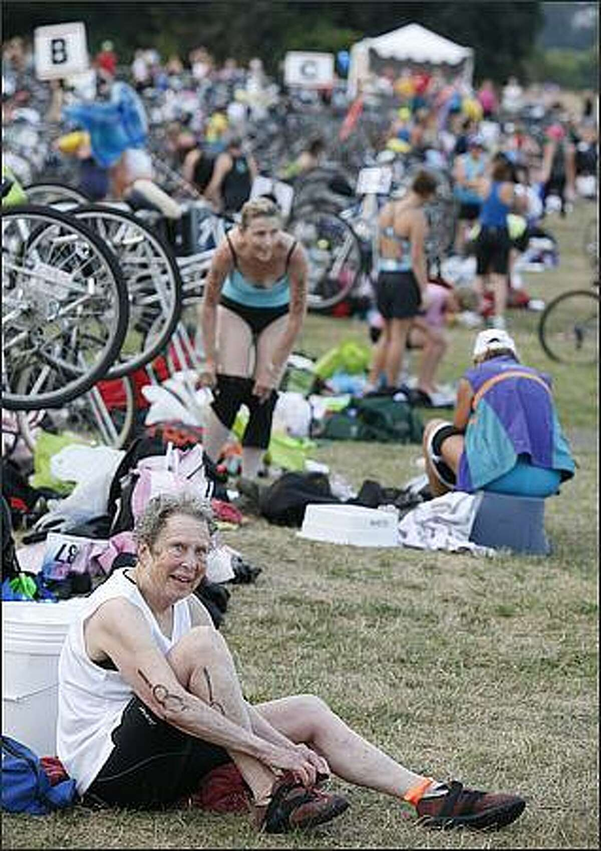 Athletes make the transition from swimming to biking in the 2008 Danskin Triathlon.