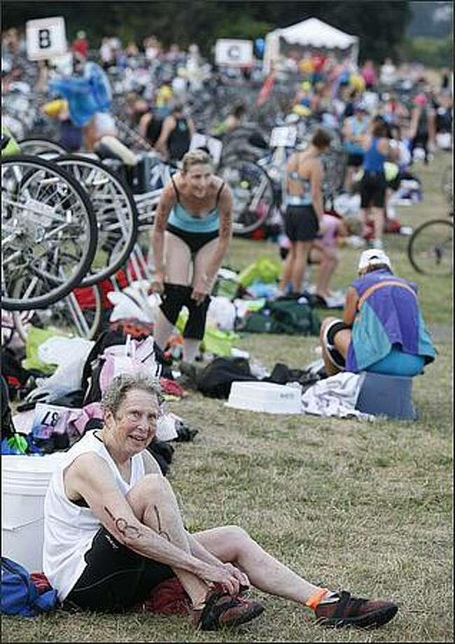 Athletes make the transition from swimming to biking in the 2008 Danskin Triathlon. Photo: Paul Joseph Brown, Seattle Post-Intelligencer
