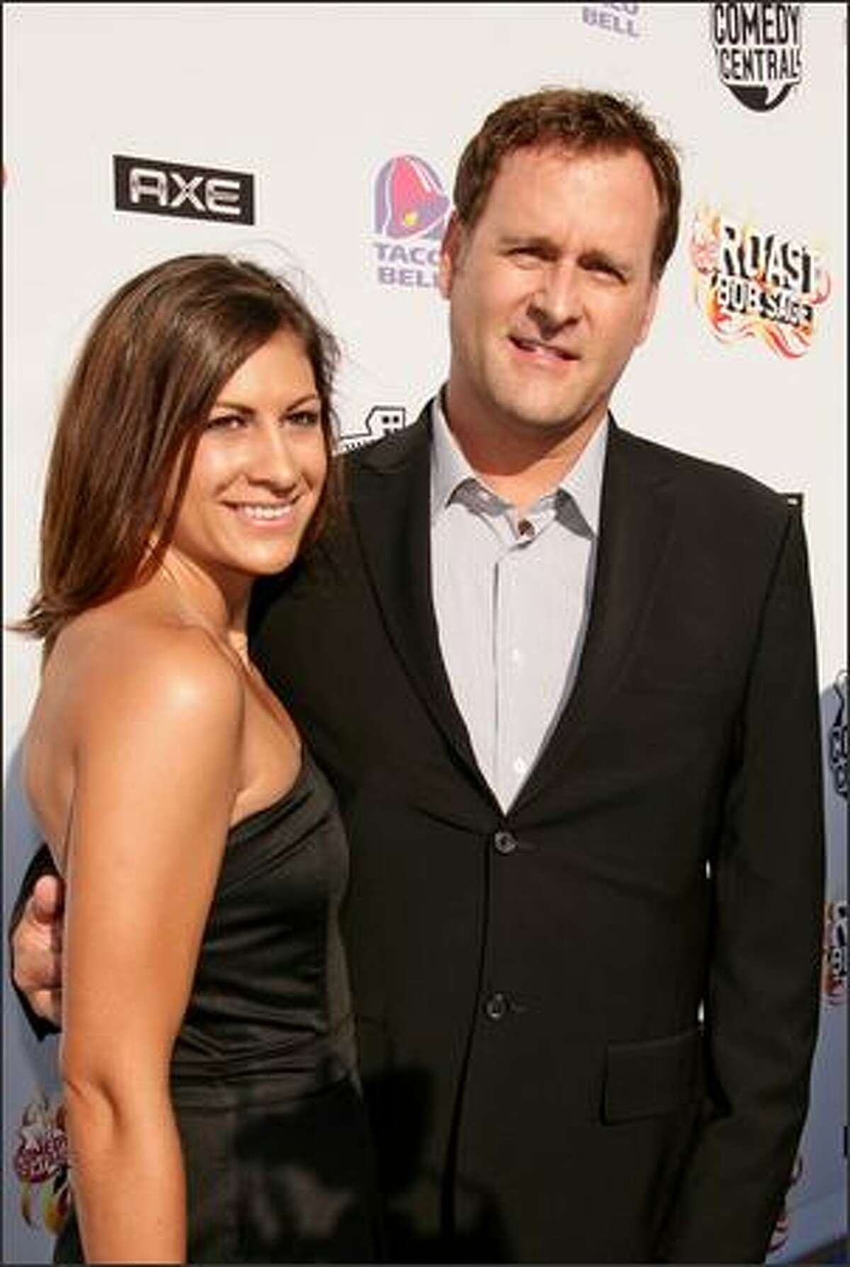 """Actor Dave Coulier (R) and guest arrives to """"Comedy Central Roast Of Bob Saget"""" at the Warners Brothers Studio Lot in Burbank, California."""
