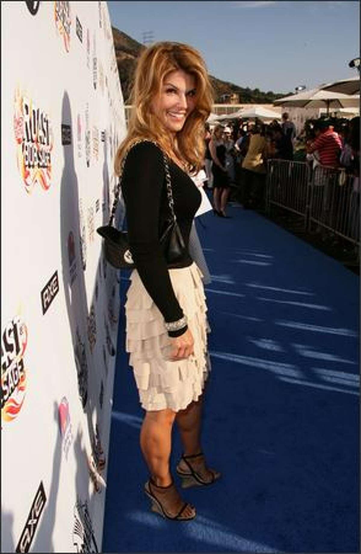 Actress Lori Loughlin arrives to