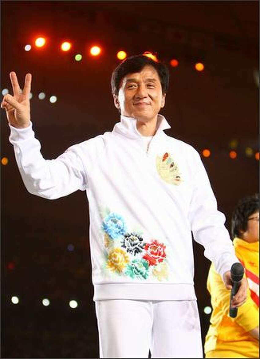 Hong Kong actor Jackie Chan waves to the crowd during the Opening Ceremony for the 2008 Beijing Summer Olympics at the National Stadium on August 8, 2008 in Beijing, China. (Photo by Jeff Gross/Getty Images)
