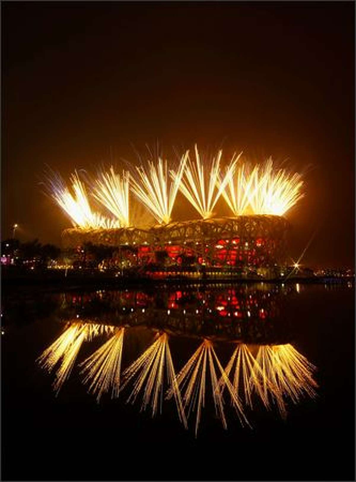 Fireworks light up the National Stadium during the Opening Ceremony for the 2008 Beijing Summer Olympics at the Pond Bridge on August 8, 2008 in Beijing, China. (Photo by Mark Dadswell/Getty Images)