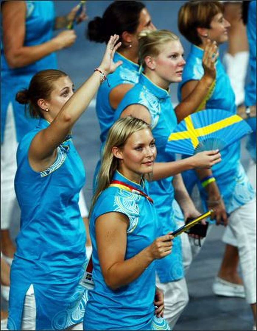 Swedish athletes enter the stadium during the Opening Ceremony for the 2008 Beijing Summer Olympics at the National Stadium on August 8, 2008 in Beijing, China. (Photo by Cameron Spencer/Getty Images)