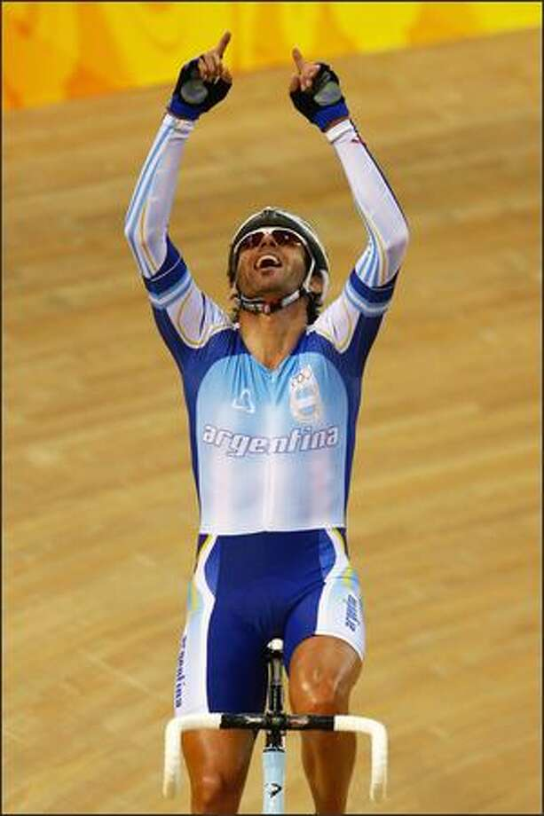 Walter Fernando Perez of Argentina celebrates the gold medal in the Men's Madison at the Laoshan Velodrome on Day 11 of the Beijing 2008 Olympic Games on Tuesday. Photo: Getty Images
